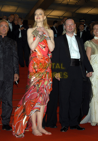 "NICOLE KIDMAN & LARS VON TRIER.leaves competition screening of ""Dogville"" .barefoot.Cannes Film Festival 2003.www.capitalpictures.com.sales@capitalpictures.com.©Capital Pictures"