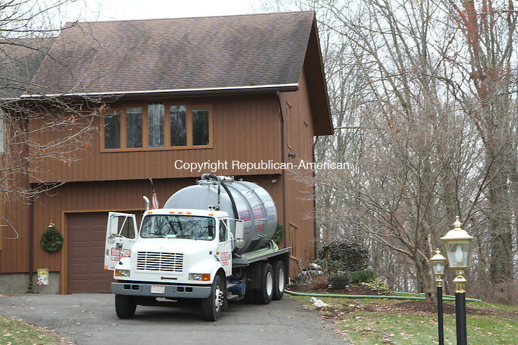 WATERTOWN, CT, 05 December 2014-120514LW03 - A sanitation company pumps the septic system at a home a t 371 Concord Drive in Watertown. Laraine Weschler Republican-American