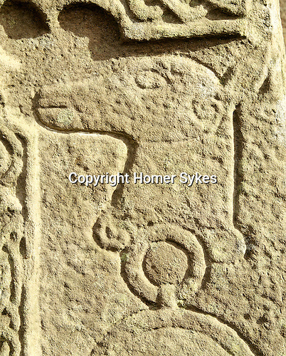 The Manse Pictish Standing Stone Glamis Angus Scotland. UK. Celtic Britain published by Orion. Pictish motifs and designs detail from front of the stone. The St Fergus Manse Cross Slab is half Christian half pagan stone is found in the garden of the manse next to St Fergus's Kirk.