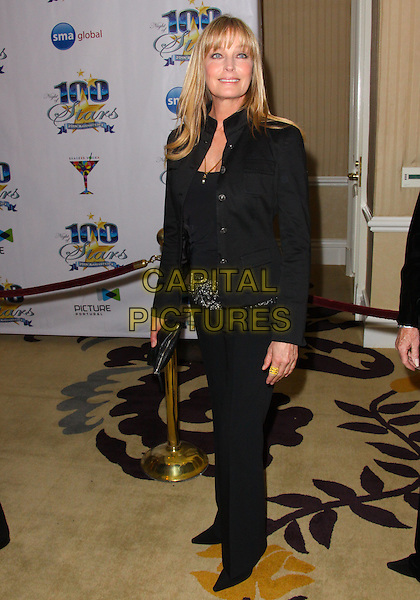 BO DEREK.Night of 100 Stars - Arrivals held at the Beverly Hills Hotel, Beverly Hills, California, USA..March 7th, 2010.full length black jacket trousers jeans denim top clutch bag .CAP/ADM/TC.©T. Conrad/AdMedia/Capital Pictures.