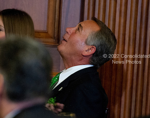 Speaker of the U.S. House of Representatives John Boehner (Republican of Ohio), listens to music at a St. Patrick's Day luncheon hosted by Members of Congress attended by United States President Barack Obama and Prime Minister Enda Kenny of Ireland in the U.S. Capitol in Washington, D.C. on Friday, March 14, 2014.<br /> Credit: Ron Sachs / Pool via CNP