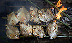 Fish cooking over a fire in Quilombo Tiningu, near Santarem, Brazil. Quilombos are Brazilian hinterland settlements founded by people of African origin, mostly slaves.