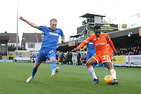 Blackpool's Marc Bola under pressure from AFC Wimbledon's Mitch Pinnock<br /> <br /> Photographer Kevin Barnes/CameraSport<br /> <br /> The EFL Sky Bet League One - AFC Wimbledon v Blackpool - Saturday 29th December 2018 - Kingsmeadow Stadium - London<br /> <br /> World Copyright &copy; 2018 CameraSport. All rights reserved. 43 Linden Ave. Countesthorpe. Leicester. England. LE8 5PG - Tel: +44 (0) 116 277 4147 - admin@camerasport.com - www.camerasport.com