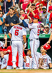 29 June 2017: Washington Nationals catcher Jose Lobaton removes Anthony Rendon's helmet after Rendon hits a two run homer in the 7th inning against the Chicago Cubs at Nationals Park in Washington, DC. The Cubs rallied against the Nationals to win 5-4 and split their 4-game series. Mandatory Credit: Ed Wolfstein Photo *** RAW (NEF) Image File Available ***