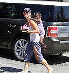 Aug 7th 2013  Exclusive <br /> <br /> Jillian Michaels smiling in Malibu California while giving her daughter Lukensia Michaels Rhoades a piggy back ride after leaving the Vitamin juice barrn. Jillian said shes been training her daughter to ride &amp; jump horses so she can compete when she gets old enough. <br /> <br /> AbilityFilms@yahoo.com<br /> 805 427 3519 <br /> www.AbilityFilms.com