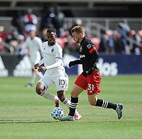 WASHINTON, DC - FEBRUARY 29: Washington, D.C. - February 29, 2020: Julian Gressel  #31 of D.C. United battles the ball with Kellyn Acosta #10 of the Colorado Rapids. The Colorado Rapids defeated D.C. United 2-1 during their Major League Soccer (MLS)  match at Audi Field during a game between Colorado Rapids and D.C. United at Audi FIeld on February 29, 2020 in Washinton, DC.