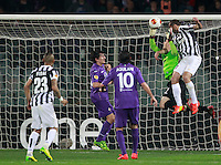 Calcio, ritorno degli ottavi di finale di Europa League: Fiorentina vs Juventus. Firenze, stadio Artemio Franchi, 20 marzo 2014. <br /> Fiorentina goalkeeper Norberto Neto, of Brazil, and Juventus defender Leonardo Bonucci, right, jump for the ball during the Europa League round of 16 second leg football match between Fiorentina and Juventus at Florence's Artemio Franchi stadium, 20 March 2014. Juventus won 1-0 to advance to the quarter-finals.<br /> UPDATE IMAGES PRESS/Isabella Bonotto