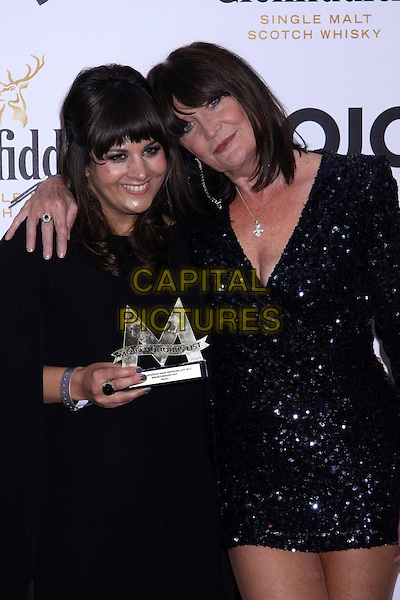Rumer (Sarah Joyce) & Sandie Shaw.The Glenfiddich MOJO Honours List award ceremony, the Brewery, Chiswell St., London, England..July 21st, 2011.half length black dress cape top singer songwriter award trophy winner sequins sequined dress arm over shoulder .CAP/COA/CC.©CC/COA/Capital .