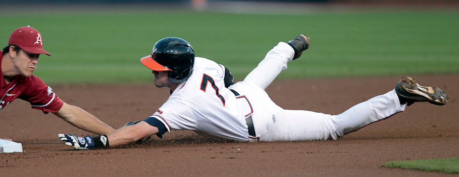 Virginia infielder Branden Cogswell (7) is tagged out by Arkansas infielder Brian Anderson (1) at second base during the game against Arkansas Saturday night at Davenport Field in Charlottesville, VA. Photo/The Daily Progress/Andrew Shurtleff