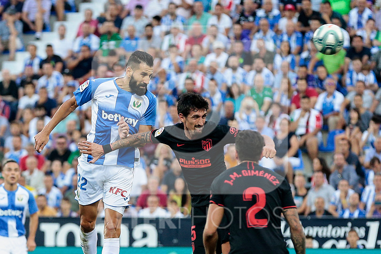 CD Leganes's Dimitrios Siovas and Atletico de Madrid's Stefan Savic during La Liga match between CD Leganes and Atletico de Madrid at Butarque Stadium in Madrid, Spain. August 25, 2019. (ALTERPHOTOS/A. Perez Meca)