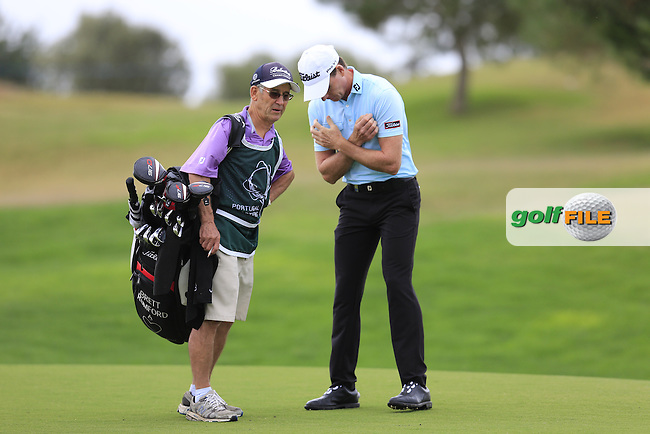 Brett Rumford (AUS) and caddy John &quot;Ronnie&quot; Roberts on the 1st green during Saturday's Round 3 of the 2016 Portugal Masters held at the Oceanico Victoria Golf Course, Vilamoura, Algarve, Portugal. 22nd October 2016.<br /> Picture: Eoin Clarke | Golffile<br /> <br /> <br /> All photos usage must carry mandatory copyright credit (&copy; Golffile | Eoin Clarke)