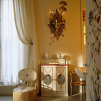 The Duchess of Windsor's bathroom is lit by flattering candlelight from sconces in trompe l'oeil settings of foliage painted by Dimitri Bouchene