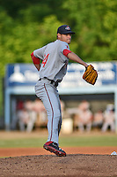 Greenville Drive starting pitcher Trey Ball #24 attempts a pickoff during a game against the Asheville Tourists at McCormick Field on May 18, 2014 in Asheville, North Carolina. The Tourists defeated the Drive 3-1. (Tony Farlow/Four Seam Images)