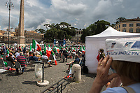 """Rome, 04/07/2020. Today, few thousand people gathered in Piazza del Popolo to attend the demonstration """"Insieme Per L'Italia Del Lavoro"""" (Together For the Italy Of Work) organised by the Italian Centre-Right Parties: Lega (League, 1.), leader Matteo Salvini MP, Forza Italia (2.), leader Silvio Berlusconi MEP but today led by the Vice-President of the Party, Antonio Tajani MEP, and Fratelli d'Italia (3.), leader Giorgia Meloni MP. The aims of the rally were to protest against the Italian coalition Government (AKA Governo Conte II, Conte's Second Government, Governo Giallo-Rosso, 4.) lead by Professor Giuseppe Conte, to call for immediate general elections, to fight the immigration, and last but not least the three political leaders launched an attack from the stage against a part of the Italian Magistracy and called for establishing an inquiry commission about Berlusconi's judiciary situation.<br /> Before the demonstration, due to the pandemic Covid-19/Coronavirus, about 4.200 chairs were placed in the square to respect the """"social distance"""" between the people attending but a lot of them were empty for the full length of the event.<br /> <br /> Footnotes & Links:<br /> 1. https://www.leganord.org<br /> 2. http://www.forza-italia.it<br /> 3. https://www.fratelli-italia.it<br /> 4. http://bit.do/feK6N<br /> A video of the event (Source, ilfattoquotidiano.it ITA) http://bit.do/fGnDd"""