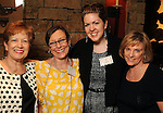 From left: Raisa Estrada, Suzanne Cetrullo, Laura Lee and Phyllis Padgett at a invitation-only reception and book-signing for Phil Collins at Torch Energy Advisors Wednesday May 9,2012. (Dave Rossman Photo)