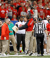 Ohio State Buckeyes head coach Urban Meyer chucks his headset while screaming at a referee during the fourth quarter in the Allstate Sugar Bowl college football playoff semifinal at Mercedes-Benz Superdome in New Orleans on Thursday, January 1, 2015. (Columbus Dispatch photo by Jonathan Quilter)