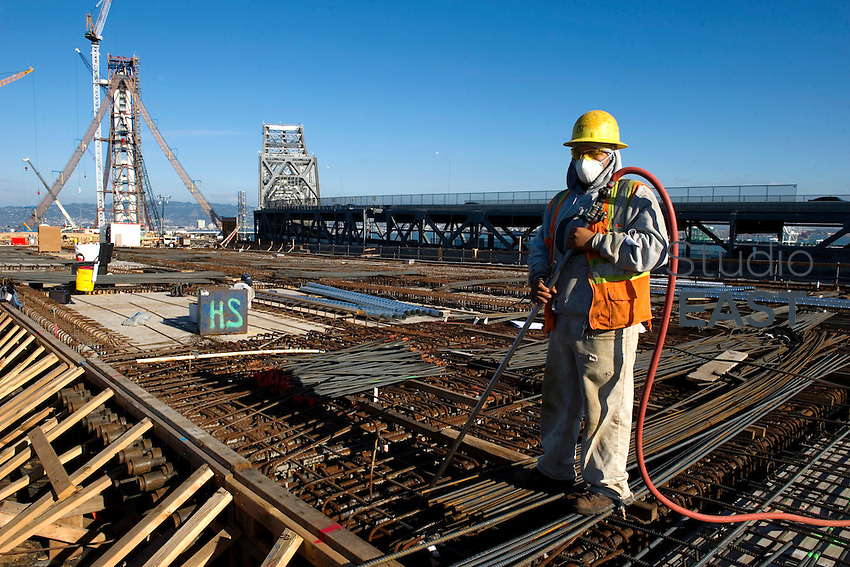 Daniel Torres is blowing debris before the pour on the Yerba Buena Island Transition Structure (YBITS), near San Francisco, CA, USA, on November 14, 2011. Photo by Lucas Schifres/Pictobank