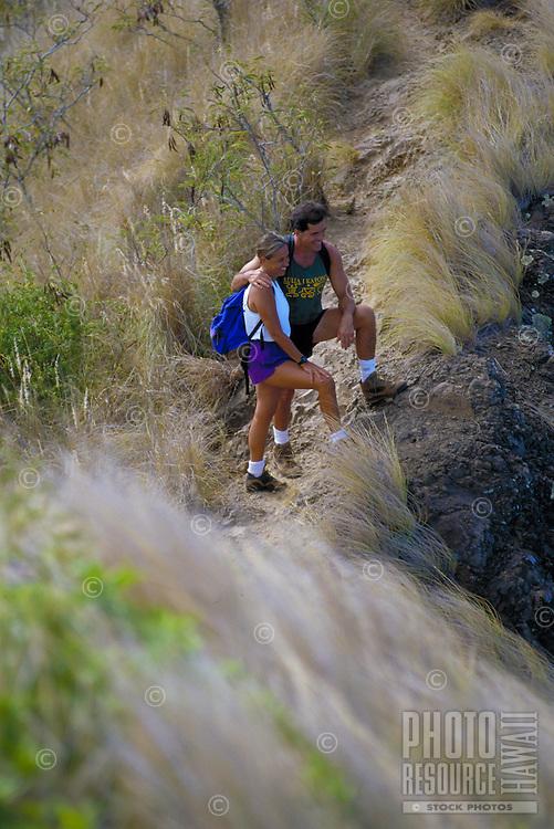 Local couple hiking Lanikai Ridge, on Oahu's windward side.