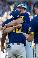 Michigan Wolverines pitcher Jeff Criswell (17) hugs teammate Angelo Smith (40) before Game 3 of the NCAA College World Series Finals on June 26, 2019 at TD Ameritrade Park in Omaha, Nebraska. Vanderbilt defeated Michigan 8-2 to win the National Championship. (Andrew Woolley/Four Seam Images)