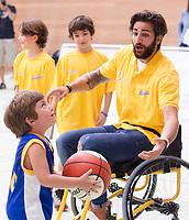 Utah Jazz's Spanish player Ricky rubio plays basketball on wheelchair