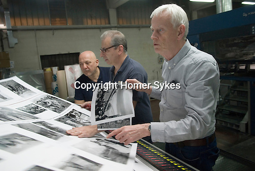 Italian book printers EBS Verona. Dewi Lewis English photography book publisher checking flat sheets for print qquality and density.