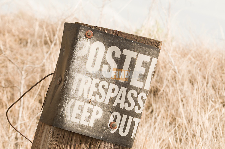 No trespassing sign posted in the country.