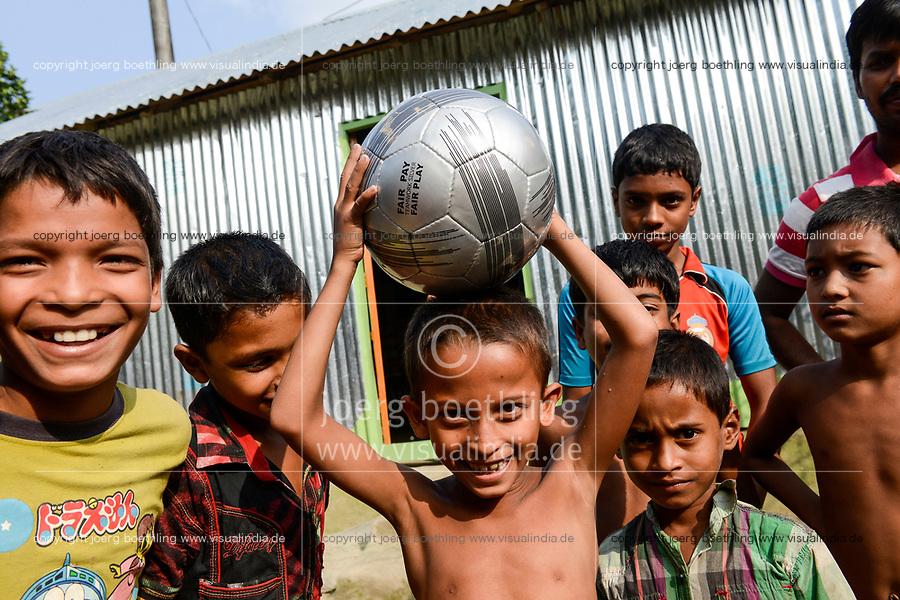 BANGLADESH, District Tangail, Kalihati, village South Chamuria, children with fair trade football / BANGLADESCH, Kinder mit fair trade Fussball