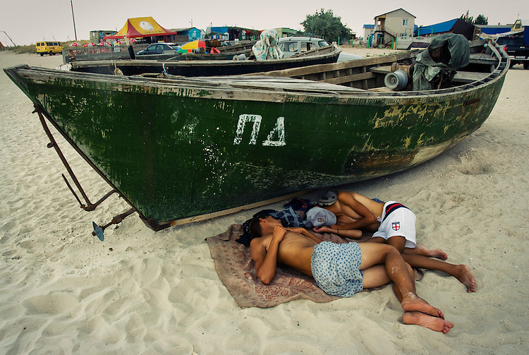 Most of men come to the seaside to fish because it's a very profitable business. But in summertime fishing is forbidden and becomes a dangerous work. Usually poachers ship out at night and sleep in the daytime. Ukraine. Azov sea. Fedotov spit. 08.2009. Oksana Yushko for Mare