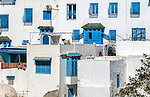 The town of Sidi Bou Said in Tunisia. It is located about 20 km from the capital, Tunis. The town was named after a religious figure who lived there, Abou Said ibn Khalef ibn Yahia Ettamini el Beji. It is popular with tourists due to its extensive use of blue and white in its architecture. It also has a reputation as a town of artists.