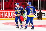Stockholm 2014-05-03 Ishockey Oddset Hockey Games  Sverige - Finland :  <br /> Sveriges Joakim Lindstr&ouml;m deppar efter matchen tillsammans med Sveriges Jimmie Ericsson <br /> (Foto: Kenta J&ouml;nsson) Nyckelord:  Oddset Hockey Games Sverige Swe Tre Kronor Finland Fin Globen Ericsson Globe Arena depp besviken besvikelse sorg ledsen deppig nedst&auml;md uppgiven sad disappointment disappointed dejected