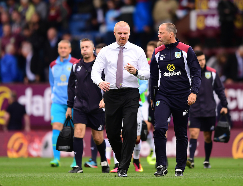 Burnley's Manager Sean Dyche speaks to Burnley&rsquo;s assistant manager Ian Woan as the pair walk off the pitch at half time<br /> <br /> Photographer Chris Vaughan/CameraSport<br /> <br /> Football - The Premier League - Burnley v Swansea City - Saturday 13th August 2016 - Turf Moor - Burnley<br /> <br /> World Copyright &copy; 2016 CameraSport. All rights reserved. 43 Linden Ave. Countesthorpe. Leicester. England. LE8 5PG - Tel: +44 (0) 116 277 4147 - admin@camerasport.com - www.camerasport.com