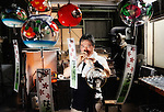 "Yutaka Shinohara blows traditional wind chimes, known as ""Edo furin,"" at his workshop at Shinohara Furin Honpo in Tokyo, Japan. The craft dates back over 200 years in Japan, and is a common sound in the summer, thought to bring mental coolness on a steamy hot summer's day."