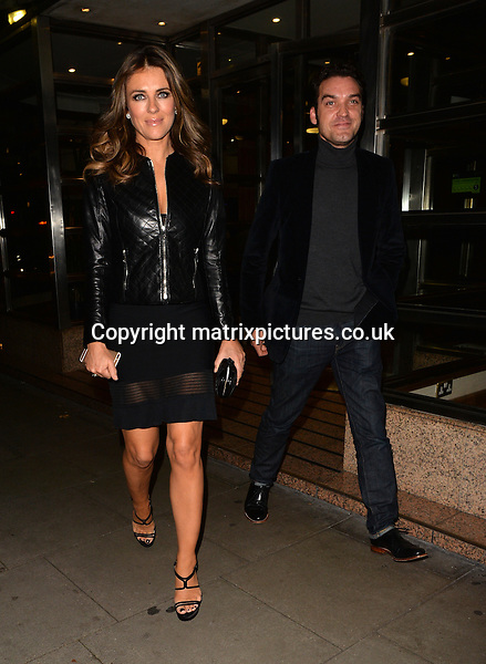 NON EXCLUSIVE PICTURE: MATRIXPICTURES.CO.UK<br /> PLEASE CREDIT ALL USES<br /> <br /> WORLD RIGHTS<br /> <br /> English actress Elizabeth Hurley is pictured leaving Scotts restaurant in Mayfair, London with her The Royals co-star Jake Maskall.<br /> <br /> The beautiful 50-year-old actress looked flawless, flashing her tanned legs in a little black dress, covered by a tight-fitting quilted black leather jacket, done up to just below her chest to reveal a glimpse of cleavage.<br /> <br /> SEPTEMBER 19th 2015<br /> <br /> REF: LTN 152919