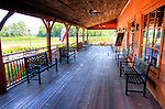 The front porch at New Kent Winery is lined with benches overlooking vineyards and gardens.  (HDR image)