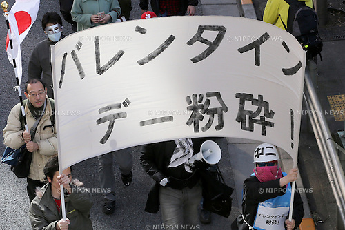 "Demonstrators holds a banner reading ""Smash Valentine's Day"" as they march through the streets of Shibuya district in Tokyo, Japan on February 14, 2015. The group called Kakuhidou, meaning  ""Revolutionary alliance of men whom women find unattractive"" protested that Valentine's Day  is only about marketing and making money by chocolate companies.  (Photo by Yuriko Nakao/AFLO)"