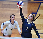 Althoff player Katie Wemhoener this the ball over as teammate Claire Franke (left) moves in. Althoff lost to Minooka in the championship game of the O'Fallon Class 4A volleyball sectional at O'Fallon HS in O'Fallon, IL on November 6, 2019.<br /> Tim Vizer/Special to STLhighschoolsports.com