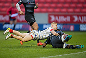 3rd February 2019, AJ Bell Stadium, Salford, England; Premiership Rugby Cup, Sale Sharks versus Newcastle Falcons; Arron Reed of Sale Sharks cannot stop Vereniki Goneva of Newcastle Falcons from scoring a try