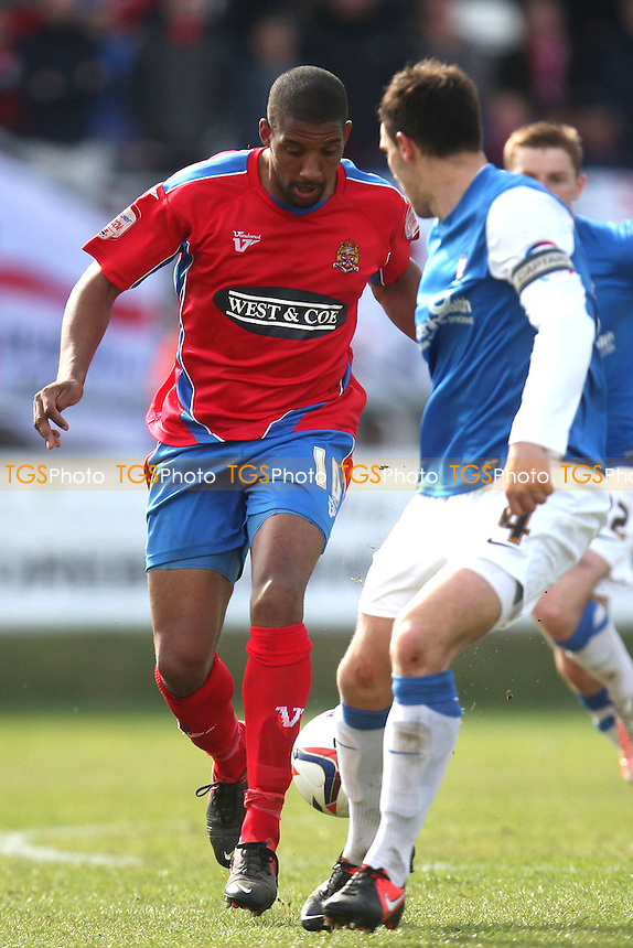 Josh Scott of Dagenham goes past Chris Smith of York City - Dagenham and Redbridge vs York City at the London Borough of Barking and Dagnham Stadium - 27/04/13 - MANDATORY CREDIT: Dave Simpson/TGSPHOTO - Self billing applies where appropriate - 0845 094 6026 - contact@tgsphoto.co.uk - NO UNPAID USE.