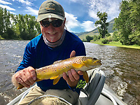 NWA Democrat-Gazette/CLAY HENRY<br /> Wayne Reed shows a brown trout he caught on Big Hole River in Montana.