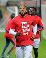 "Ashley Williams of Swansea warms up wearing a ""Show Racism the Red Card"" shirt before the Barclays Premier League match between Swansea City and Stoke City played at the Liberty Stadium, Swansea on October 19th 2015"