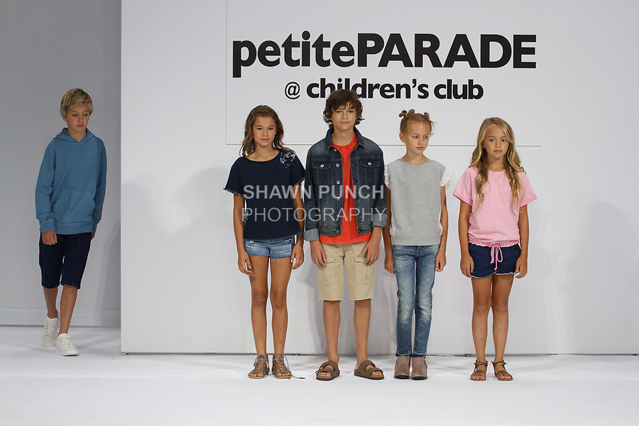 Child model walks runway in an outfit from the AG Kids Adriano Goldschmied Spring 2018 collection, during the petitePARADE Spring Summer 2018 fashion show with Children's Club, at the Javits Center on August 6, 2017.
