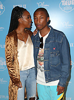 LOS ANGELES, CA - AUGUST 10: Kelly Rowland and Pharrell Williams at the Netflix Series Premiere Of True And The Rainbow Kingdom at the Pacific Theatres at The Grove in Los Angeles, California on August 10, 2017. <br /> CAP/MPI/FS<br /> &copy;FS/MPI/Capital Pictures
