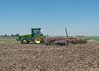 Drew Thompson with Thompson Farms, discs a field for planting near Holly, Colorado, Friday, May 20, 2016. Thompson Farms, a large farming operation, hold junior water rights to irrigate with water diverted from the Arkansas River through the Amity Canal.<br /> <br /> Photo by Matt Nager
