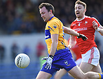 David Tubridy of Clare in action against James Craven of Louth during their national League game in Cusack Park. Photograph by John Kelly.