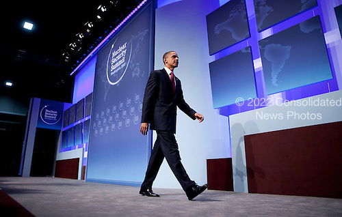 United States President Barack Obama walks off stage during a news conference at the Nuclear Security Summit at the Washington Convention Center in Washington, D.C., U.S., on Tuesday, April 13, 2010. Obama urged world leaders today to confront the prospect of nuclear terrorism and take concrete action to head off what he called one of the greatest threats to global security. .Credit: Andrew Harrer / Pool via CNP