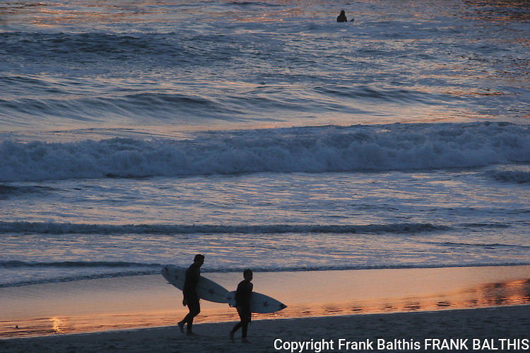 surfers at sunset in Oceanside