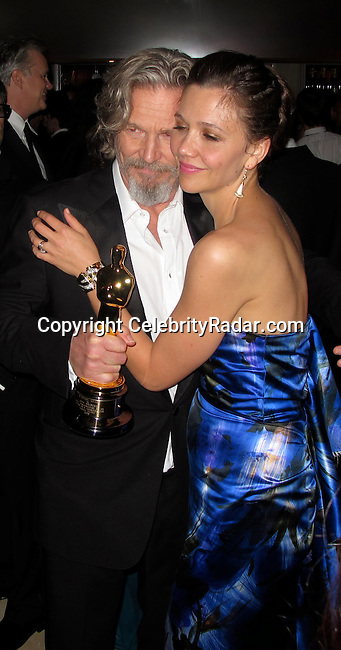 Jeff Bridges and Maggie Gyllenhaal..Vanity Fair Oscar Party..Sunset Tower Hotel..Hollywood, CA, USA..Sunday, March 07, 2010..Photo By CelebrityRadar.com.To license this image please call (212) 410 5354; or Email: CelebrityRadar10@gmail.com ; .website: www.CelebrityRadar.com.