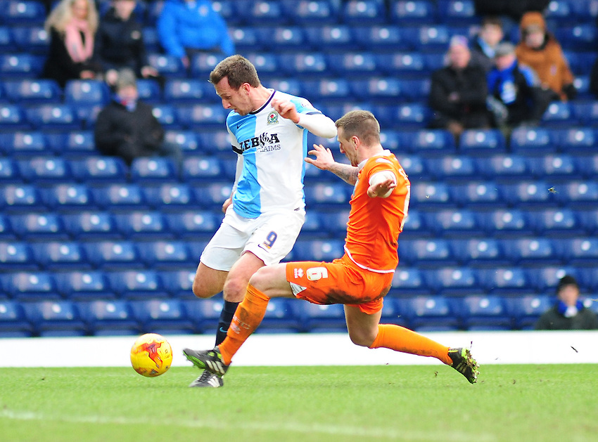 Blackburn Rovers' Chris Brown looks to get past Blackpool's Peter Clarke<br /> <br /> Photographer Andrew Vaughan/CameraSport<br /> <br /> Football - The Football League Sky Bet Championship - Blackburn Rovers v Blackpool - Saturday 21st February 2015 - Ewood Park - Blackburn<br /> <br /> &copy; CameraSport - 43 Linden Ave. Countesthorpe. Leicester. England. LE8 5PG - Tel: +44 (0) 116 277 4147 - admin@camerasport.com - www.camerasport.com