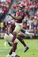 Landover, MD - November 18, 2018: Washington Redskins cornerback Fabian Moreau (31) breaks up a pass during the  game between Houston Texans and Washington Redskins at FedEx Field in Landover, MD.   (Photo by Elliott Brown/Media Images International)