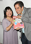 Ann Harada and Seth Rudetsky attends the Seth Rudetsky Book Launch Party for 'Seth's Broadway Diary' at Don't Tell Mama Cabaret on October 22, 2014 in New York City.
